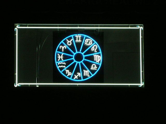 Interior Neon Sign Mounted On A Black Acrylic Piece
