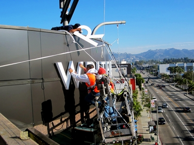 Installation of front-lit channel letters.