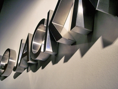 Fabricated brush stainless steel letters